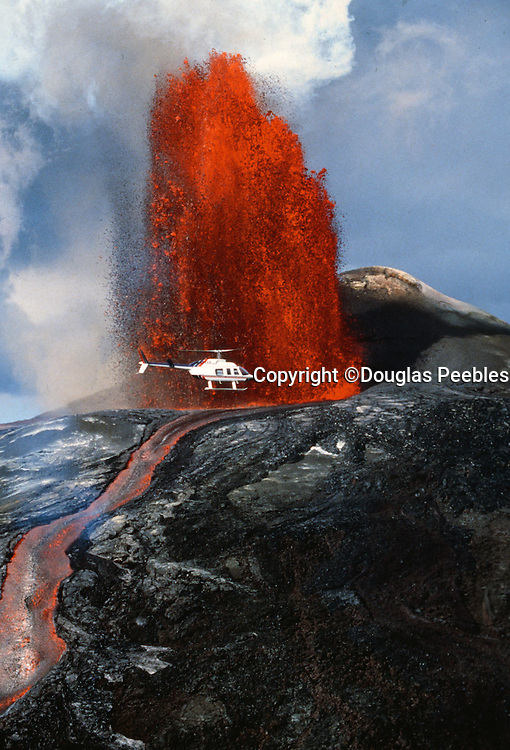 Helicopter in front of Kilauea Volcano, Island of Hawaii