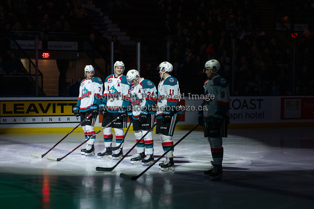 KELOWNA, CANADA - DECEMBER 29: Libor Zabransky #7, Kaedan Korczak #6, Kyle Topping #24, Erik Gardiner #11 and Mark Liwiski #9 of the Kelowna Rockets stand on the blue line as the starting line up against the Kamloops Blazers on December 29, 2018 at Prospera Place in Kelowna, British Columbia, Canada.  (Photo by Marissa Baecker/Shoot the Breeze)