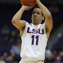 Jan 04, 2010; Baton Rouge, LA, USA;  LSU Tigers guard Bo Spencer (11) shoots against the McNeese State Cowboys during the second half at the Pete Maravich Assembly Center.  Mandatory Credit: Derick E. Hingle-US PRESSWIRE
