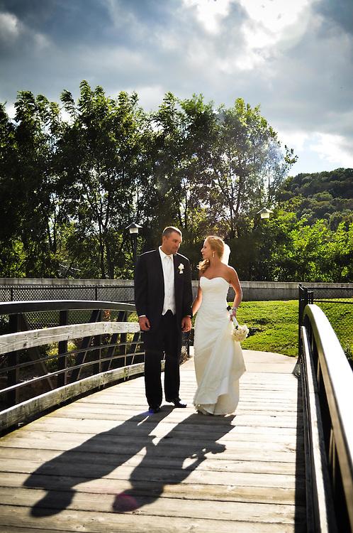 Abby & Matt cross over a bridge together; Richland Center, WI