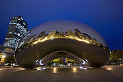 Cloud Gate Sculpture or The Bean with downtown skyline reflected in polished surface Millennium Park in Chicago USA