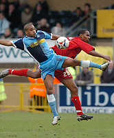 Photo: Leigh Quinnell.<br /> Wycombe Wanderers v Shrewsbury Town. Coca Cola League 2. 11/03/2006. Wycombes Jermaine Easter jumps with Shrewsburys Sagi Burton.
