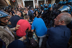 September 7, 2017 - Rome, Italy - Moments of tension in Rome where some demonstrators of the movements for the house were lifted and dragged in weight by policemen. (Credit Image: © Andrea Ronchini/Pacific Press via ZUMA Wire)