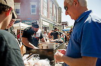 Kevin Halligan and the Local Eatery crew serve up coffee encrusted beef sandwiches at Laconia's downtown Coffee Festival on Saturday afternoon.  (Karen Bobotas/for the Laconia Daily Sun)