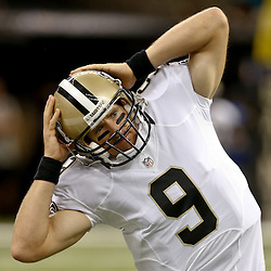 Aug 28, 2014; New Orleans, LA, USA; New Orleans Saints quarterback Drew Brees (9) warms up before a preseason game against the Baltimore Ravens at Mercedes-Benz Superdome. The Ravens defeated the Saints 22-13. Mandatory Credit: Derick E. Hingle-USA TODAY Sports