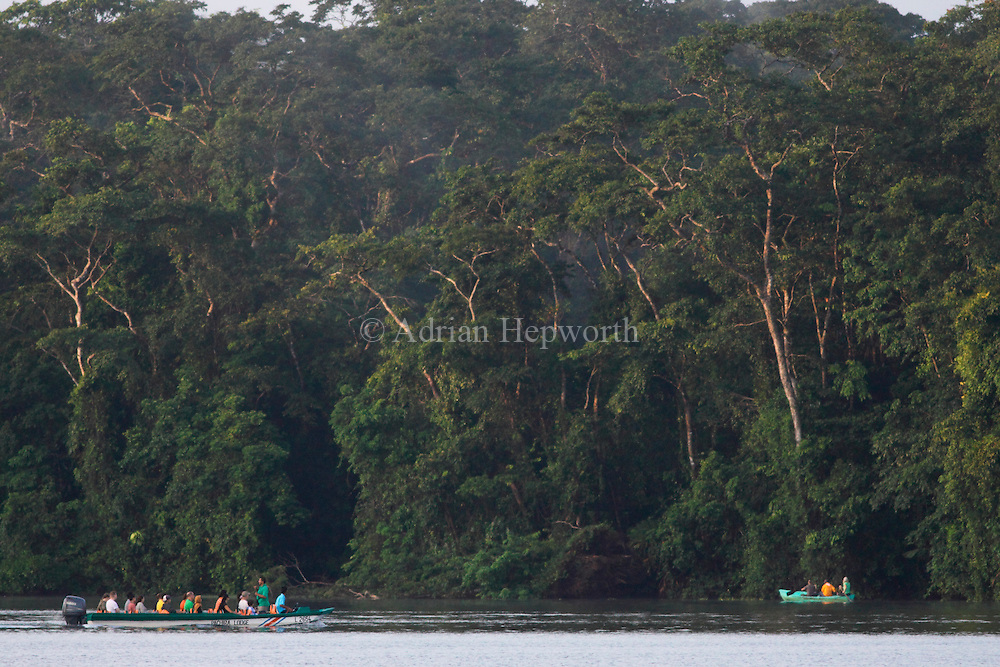 Tourist boats on natural rainforest canal in Tortuguero National Park. Costa Rica. <br />