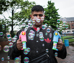 © Licensed to London News Pictures. <br /> 06/06/2014. <br /> <br /> Middlesbrough, England<br /> <br /> A stall holder releases bubbles at the start of the 24th Middlesbrough Mela event.<br /> <br /> The Middlesbrough Mela has become the largest and most spectacular multicultural festival in the North East.<br /> <br /> Photo credit : Ian Forsyth/LNP