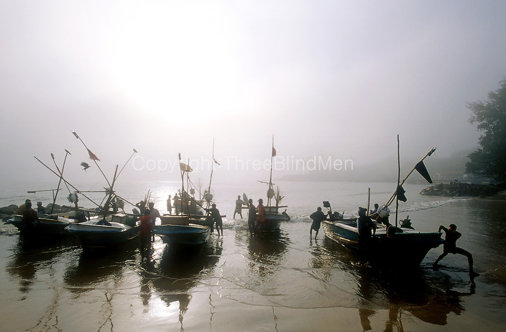 A Misty morning at the Galle Fishing harbour near the Galle Fort..