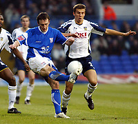 Photo: Chris Ratcliffe.<br />Ipswich Town v Portsmouth. The FA Cup. 07/01/2006.<br />Gavin Williams (L) of Ipswich and Gary O'Neil battle it out.