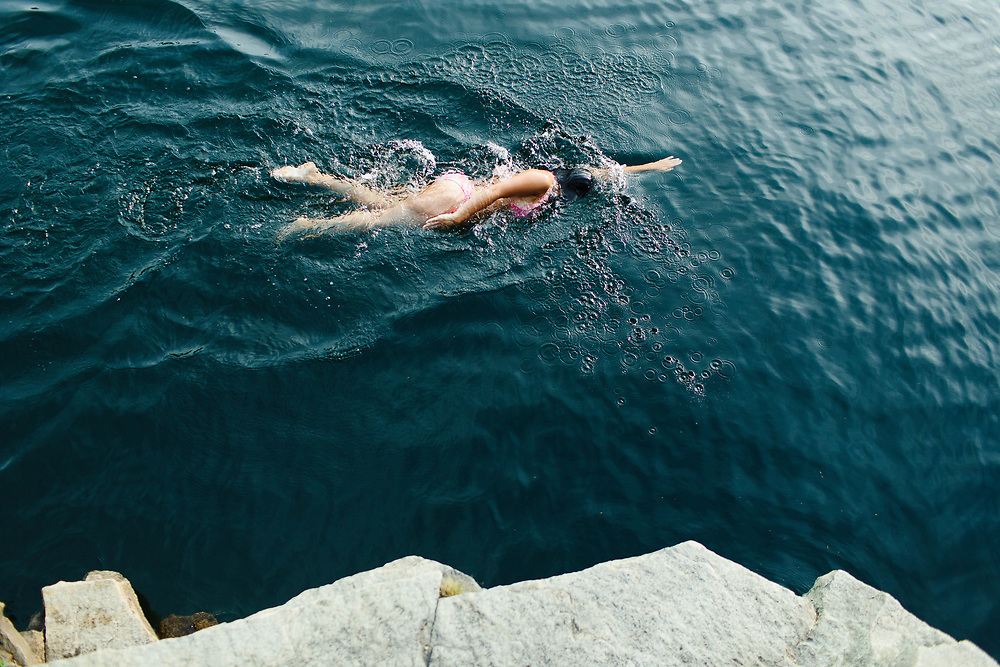 Young woman swimming in quarry