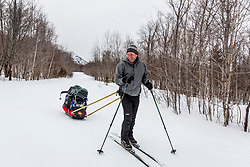 A skier tows a sled in the backcountry of Maine's Katahdin Woods and Waters National Monument.
