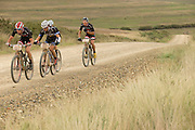 Ariane Kleinhans and Annika Langvad manage to stay ahead of Ester Suss and Sally Bigham of Team Meerendal (seen in the background) to win stage 3 of the 2014 Absa Cape Epic Mountain Bike stage race held from Arabella Wines in Robertson to The Oaks Estate in Greyton, South Africa on the 26 March 2014<br /> <br /> Photo by Greg Beadle/Cape Epic/SPORTZPICS