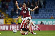 George Dobson of Sunderland is fouled by Jay Rodriguez of Burnley   during the EFL Cup match between Burnley and Sunderland at Turf Moor, Burnley, England on 28 August 2019.