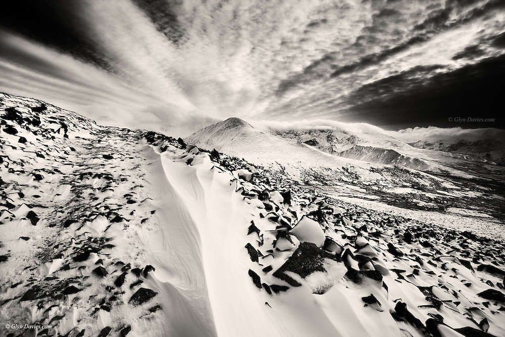 I love the way the virgin snow of the drift seems to funnel upwards like an ice cream cone before exploding outwards across the sky in a 180º spread. <br />