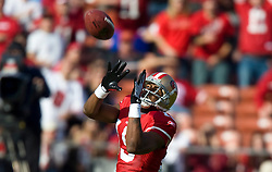 Dec 27, 2009; San Francisco, CA, USA;  San Francisco 49ers wide receiver Michael Crabtree (15) makes a reception against the Detroit Lions during the first quarter at Candlestick Park. San Francisco defeated Detroit 20-6.