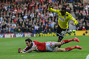 Moses Odubajo fouls Lee Tomlin during the Sky Bet Championship Play Off Second Leg match between Middlesbrough and Brentford at the Riverside Stadium, Middlesbrough, England on 15 May 2015. Photo by Simon Davies.