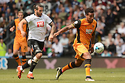 Hull City midfielder Tom Huddlestone slips away from Derby County midfielder Bradley Johnson during the Sky Bet Championship play-off first leg match between Derby County and Hull City at the iPro Stadium, Derby, England on 14 May 2016. Photo by Alan Franklin.