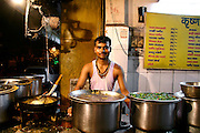 youth at dhaba in paharganj, delhi, india