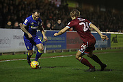 Port Vale defender Nathan Smith (24) and AFC Wimbledon defender & captain Barry Fuller (2) battle for possession during the EFL Sky Bet League 1 match between AFC Wimbledon and Port Vale at the Cherry Red Records Stadium, Kingston, England on 17 December 2016. Photo by Stuart Butcher.