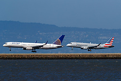 Boeing 757-224 (N17139) operated by United Airlines and Embraer ERJ-175LR (N215NN) operated by Compass Airlines for American Eagle landing on runways 28L and 28R at San Francisco International Airport (KSFO), San Francisco, California, United States of America