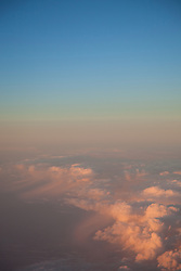 """Sunset Above the Clouds 2"" - This sunset was photographed from an airplane above the clouds."