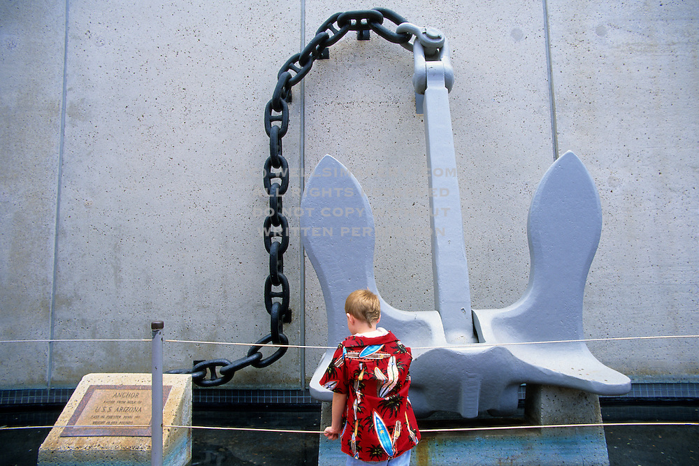 Image of a little boy looking at the original anchor from the USS Arizona at Pearl Harbor, Honolulu, Oahu, Hawaii, America West (not model released)