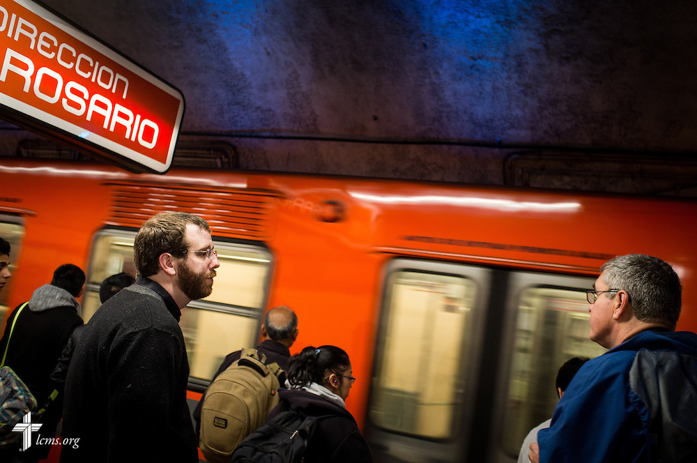 The Rev. Andrew Schlund (left) and the Rev. Daniel Conrad, LCMS missionaries to Mexico, board a subway on Friday, Jan. 13, 2017, in Mexico City. The two traveled to a Catholic Augustinian seminary to speak about Lutheranism. LCMS Communications/Erik M. Lunsford