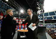 Senator Hillary Rodham Clinton (D) of New York is greeted by moderator Keith Olbermann of MSNBC at  an AFL-CIO Working Families Presidential Candidates Forum at Soldier Field in Chicago Tuesday evening.