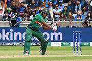 Mohammad Saifuddin of Bangladesh plays an attacking shot during the ICC Cricket World Cup 2019 match between Bangladesh and India at Edgbaston, Birmingham, United Kingdom on 2 July 2019.
