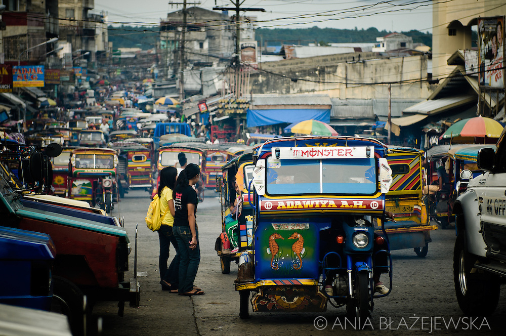 Philippines, Tawi Tawi. Trafic in Bongao, the capital of Tawi Tawi. Main street full of autorickshaws during rush hours.