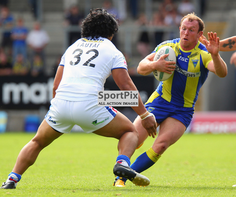 Micky Higham is met by Taulima Tautai, Warrington Wolves vs Wakefield Wildcats, Super League, 10 August 2013. (c) Thomas Miller | SportPix.org.uk