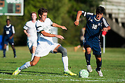 Burlington's Raushan Temirov (18) runs with the ball during the boys soccer game between the The Burlington Seahorses and the Rice Green Knights at Rice Memorial high School on Tuesday afternoon September 15, 2015 in South Burlington, Vermont. (BRIAN JENKINS/for the FREE PRESS)
