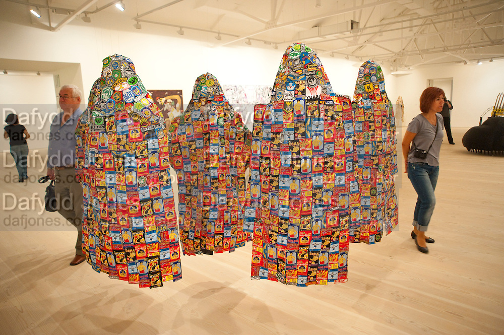 Gallerygoers viewing the Indonesian Eye Contemporary Art Exhibition, Saatchi Gallery. London. Saturday 10 September 2011. <br /> <br />  , -DO NOT ARCHIVE-&copy; Copyright Photograph by Dafydd Jones. 248 Clapham Rd. London SW9 0PZ. Tel 0207 820 0771. www.dafjones.com.