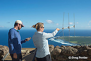 NOAA researcher Dr. Charles Littnan holds receiver while Duke University PhD candidate Kenady Wilson turns a VHF antenna to locate a Hawaiian monk seal, Monachus schauinslandi, carrying a Crittercam and tracking instrumentation package, Kalaupapa Lookout, Molokai, Hawaii, USA, Ho Ike a Maka Project