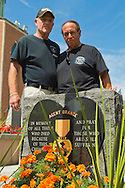 East Meadow, New York, U.S. - September 3, 2014 - L-R, PAT YNGSTROM, of Merrick, U.S. Army Paratrooper, Vietnam War Veteran, and STEVE BONOM, of Massapequa, U.S. Navy, Vietnam War Veteran, are standing behind the Agent Orange Monument at Eisenhower Park, after participating in a press conference held by congressional candidate K. Rice. They are members of Rice's newly formed Veterans Advisory Committee, and casualties of Agent Orange during the Vietnam War.