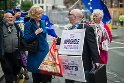 © Licensed to London News Pictures. 04/10/2017. Manchester, UK.  Andrea Leadsom walking past the demonstration on the final day of the Tory Party Conference. The protest was as part of the Take Back Manchester festival to protest the conference taking part in the city.  Photo credit: Steven Speed/LNP