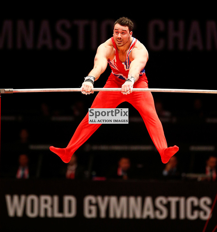 2015 Artistic Gymnastics World Championships being held in Glasgow from 23rd October to 1st November 2015...Kristian Thomas (Great Britain) competing in the Horizontal Bar competition..(c) STEPHEN LAWSON | SportPix.org.uk
