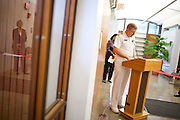 Captain Curtis Stevens, commanding officer at the Naval ROTC consortium making his remarks while Drew Faust is reflected in the windown. Harvard University President Drew Faust welcomes back Naval ROTC to campus with the opening of offices inside Hilles Student Center on Campus.  Present also was Dean of Harvard College Evelynn M. Hammonds and Captain Curtis Stevens, commanding officer at the Naval ROTC consortium. Justin Ide/Harvard Staff Photographer