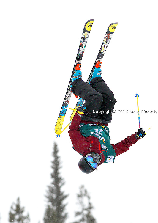 SHOT 1/11/13 10:48:03 AM - Canadian skier Cassie Sharpe gets inverted high above the pipe during the ladies' Ski Halfpipe finals at the U.S. Snowboarding and Freeskiing Grand Prix at Copper Mountain, Co. (Photo by Marc Piscotty / © 2013)