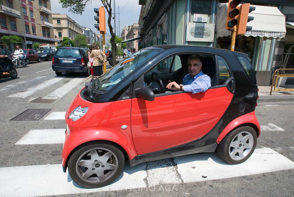 Street life. Businessman in a Smart.