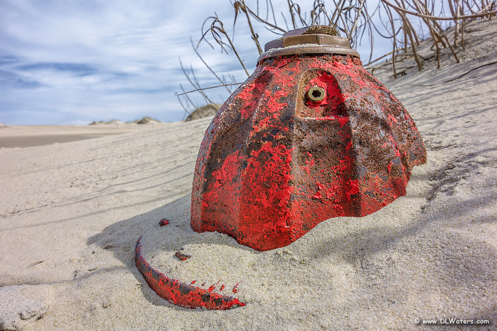 Fire hydrant buried in a sand dune at Oregon Inlet on the Outer Banks.