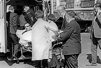 Republican Labour MP, Gerry Fitt, is stretchered to an ambulance after collapsing at Parliament Buildings, Stormont, N Ireland, 4th June 1969. Extreme right is Mid-Antrim Ulster Unionist MP, Robert Simpson, a medical doctor, who rendered emergency assistance. 196906040186b<br /> <br /> Copyright Image from Victor Patterson,<br /> 54 Dorchester Park, <br /> Belfast, UK, BT9 6RJ<br /> <br /> t1: +44 28 9066 1296 (from Rep of Ireland 048 9066 1296)<br /> t2: +44 28 9002 2446 (from Rep of Ireland 048 9002 2446)<br /> <br /> m: +44 7802 353836<br /> <br /> e: victorpatterson@me.com<br /> www.victorpatterson.com<br /> <br /> Please see my Terms and Conditions of Use at www.victorpatterson.com. It is IMPORTANT that you familiarise yourself with them.<br /> <br /> Images used on the Internet must be visibly watermarked i.e. © Victor Patterson<br /> within the body of the image and copyright metadata must not be deleted. Images <br /> used on the Internet have a size restriction of 4kbs and will be chargeable at current<br />  NUJ rates unless agreed otherwise.<br /> <br /> This image is only available for the use of the download recipient i.e. television station, newspaper, magazine, book publisher, etc, and must not be passed on to any third <br /> party. It is also downloaded on condition that each and every usage is notified within 7 days to victorpatterson@me.com<br /> <br /> The right of Victor Patterson to be identified as the author is asserted in accordance with The Copyright Designs And Patents Act (1988). All moral rights are asserted.