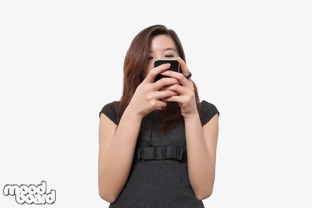 Young businesswoman using smart phone over white background
