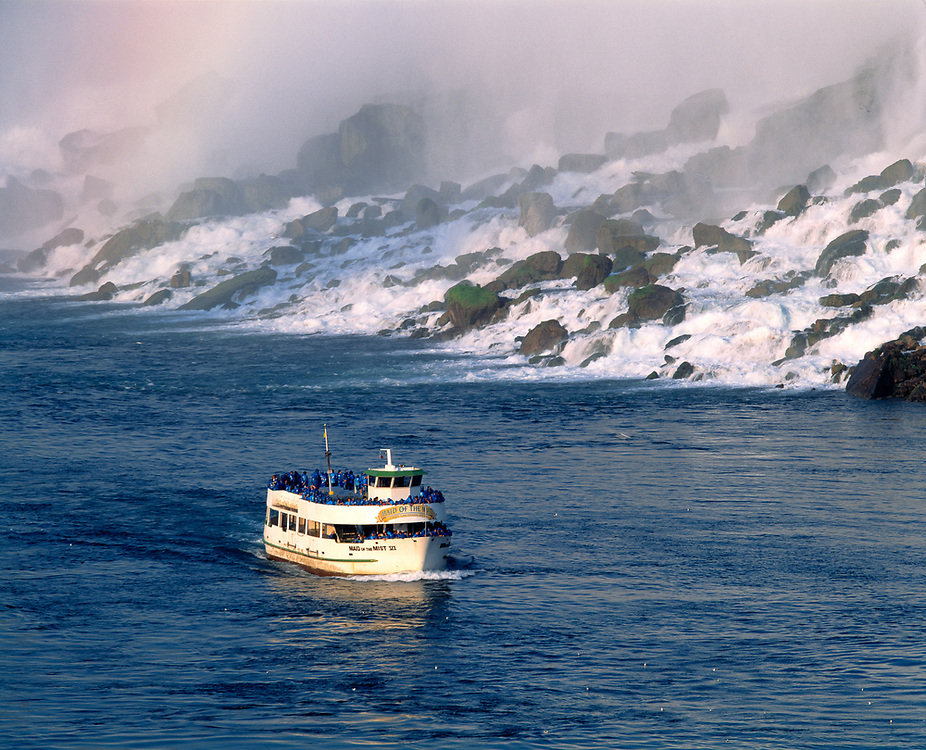 A tourist boat, Maid of the Mist, plies the cold waters near Niagara Falls, New York.