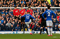 Football - 2019 / 2020 Premier League - Everton vs. Manchester United<br /> <br /> Gylfi Sigurdsson of Everton lifts a free kick over the Manchester United wall, at Goodison Park.<br /> <br /> COLORSPORT/ALAN MARTIN