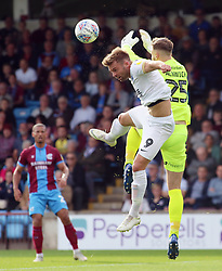 Matt Godden of Peterborough United challenges Jak Alnwick of Scunthorpe United - Mandatory by-line: Joe Dent/JMP - 13/10/2018 - FOOTBALL - Glanford Park - Scunthorpe, England - Scunthorpe United v Peterborough United - Sky Bet League One
