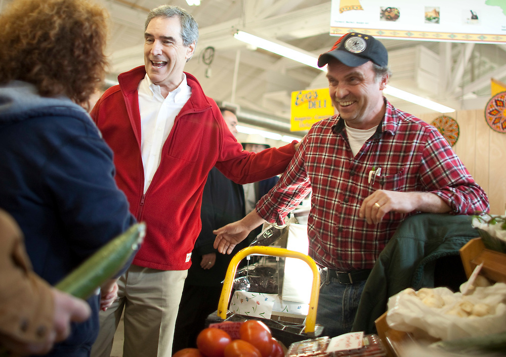 Liberal leader Michael Ignatieff talks with shoppers and merchants during a campaign stop at a farmers market in Guelph, Ontario April 30, 2011.<br /> REUTERS/Geoff Robins