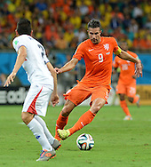 Robin van Persie of Netherlands and Giancarlo Gonzalez of Costa Rica during the 2014 FIFA World Cup match at the Itaipava Arena Fonte Nova, Nazare, Bahia<br /> Picture by Stefano Gnech/Focus Images Ltd +39 333 1641678<br /> 05/07/2014