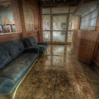 Old very moldy hotel.<br /> Hotel Schimmelig. Interior with sofa
