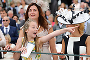 A young racegoer shouts her horse home  during the Yorkshire Ebor Festival at York Racecourse, York, United Kingdom on 22 August 2018. Picture by Mick Atkins.